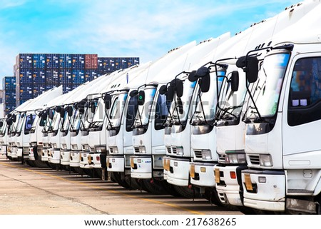 Truck in a row with containers background - stock photo