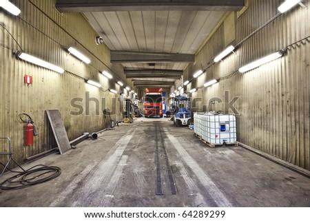 Truck in an auto repair shop - stock photo