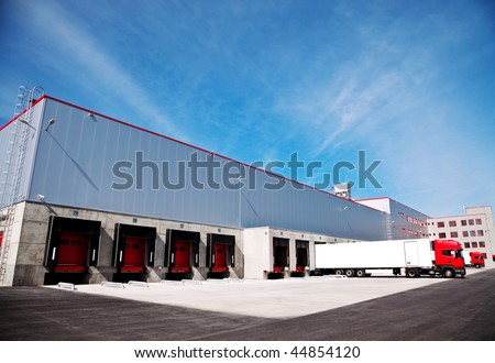 truck in front of an industrial logistics building - stock photo