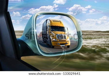 Truck in the rear-view mirror - stock photo
