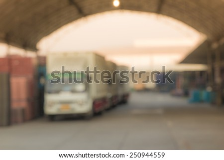 truck in warehouse by blur image - stock photo