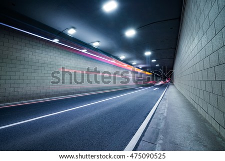 Truck light trails in tunnel