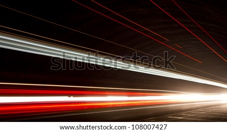 Truck light trails in tunnel. Art image . Long exposure photo taken in a tunnel. check my lightbox  http://www.shutterstock.com/lightboxes.mhtml?lightbox_id=12253330&from=lihp&pos=0