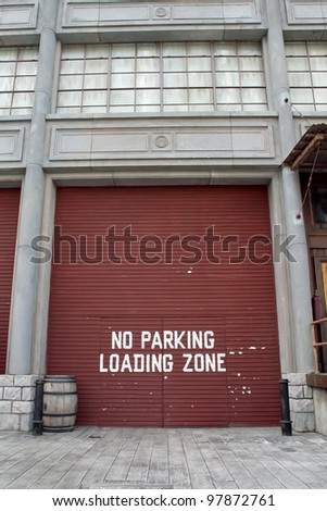 Truck loading dock at warehouse or Shipping Facility - stock photo