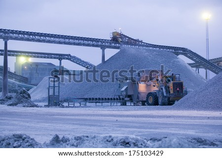 Truck moving limestone in a quarry on the island Gotland in Sweden - stock photo