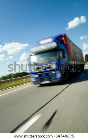 Truck moving with high speed - stock photo
