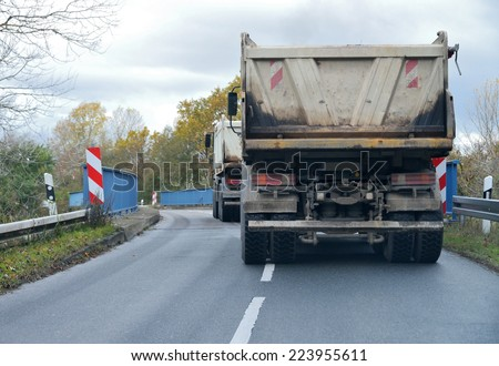 truck on a road - Dangerous Situation - stock photo