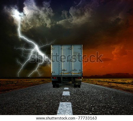 Truck on a road in the evening - stock photo