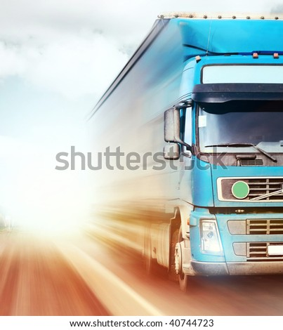 Truck on blurry road - stock photo