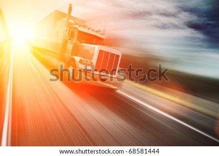 Truck on freeway at sunset. Copyspace. - stock photo