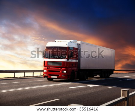 truck on highway and sunset - stock photo