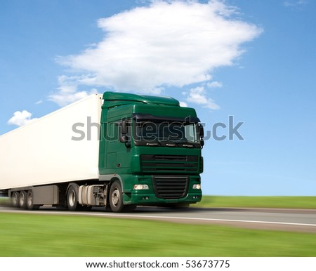 Truck on the road-blurred motion - stock photo