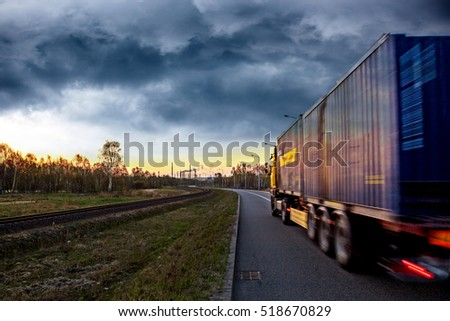 Truck on the road in stormy day.
