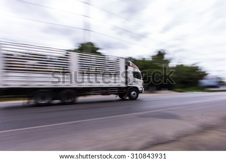 truck panning camera in road - stock photo