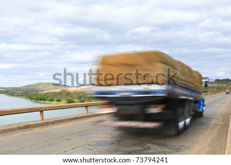 Truck passing over bridge over Sao Francisco river, Brazil. - stock photo