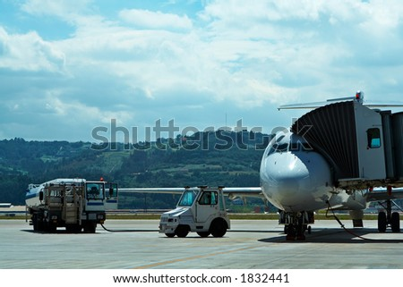 Truck refueling an airplane on the airport