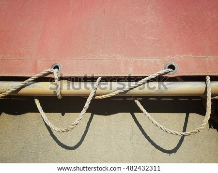 truck's red cover with rope