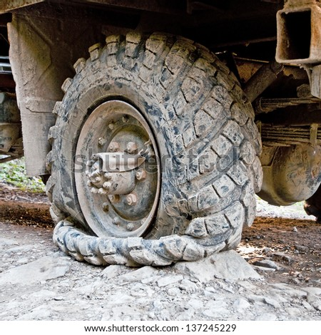 truck stands on the sidelines with a broken wheel - stock photo