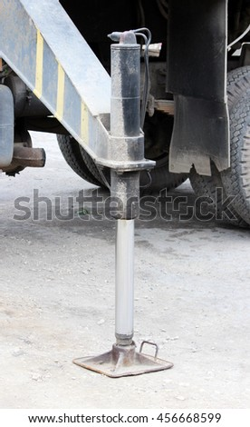 Truck strong outrigger stabilizing legs extended. Working leg  from a crane. - stock photo