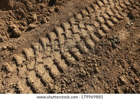 truck traces in mud - stock photo