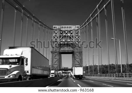 Truck traffic on the George Washington Bridge over the Hudson River - stock photo