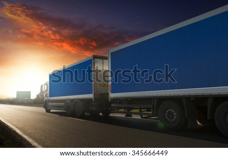 Truck trailer on the highway in a commercial trip. - stock photo