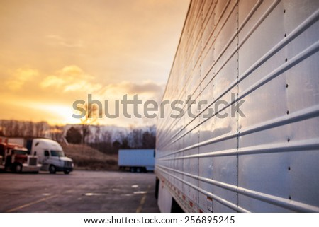 Truck trailers in sunset