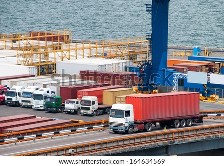 truck transport container in port - stock photo