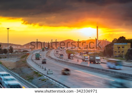 Truck transport container on the road to oil refinery - stock photo