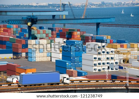 truck transport container to warehouse near the sea - stock photo