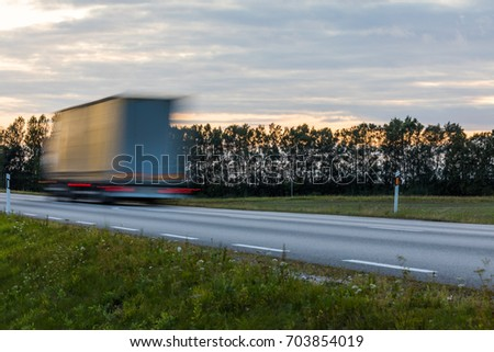 Truck transport on the road with motion blur. Blurred image background. Colorful wallpaper with copy space.