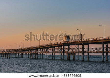 truck transportation bridge over water with sunset