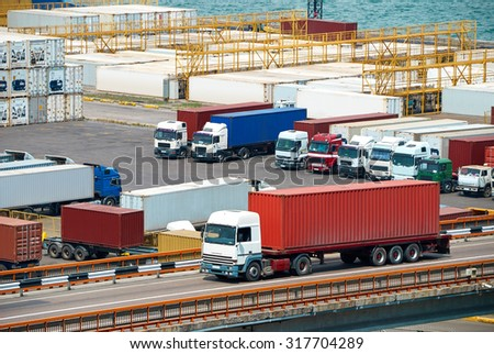 truck transportation container from ship near sea - stock photo