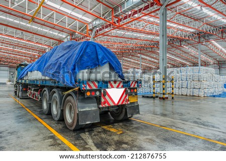 Truck transporting at port in warehouse - stock photo