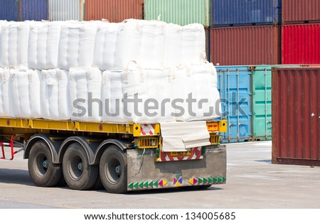 Truck transporting in port for cargo. - stock photo