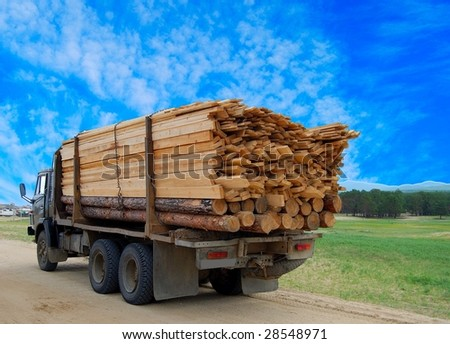 Truck transporting logs - stock photo