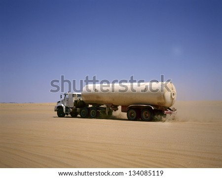 Truck transporting oil in the Arab desert - stock photo