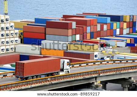 truck transports container to a warehouse near the sea - stock photo