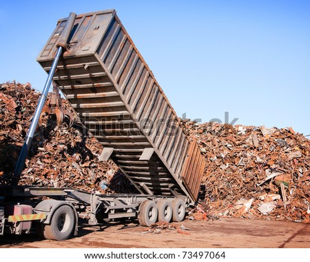 truck unloading metal scrap - stock photo