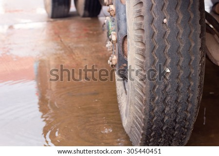 Truck wheels on a wet road. - stock photo