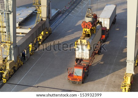 Truck with a container in the harbor of Rotterdam, Netherlands - stock photo