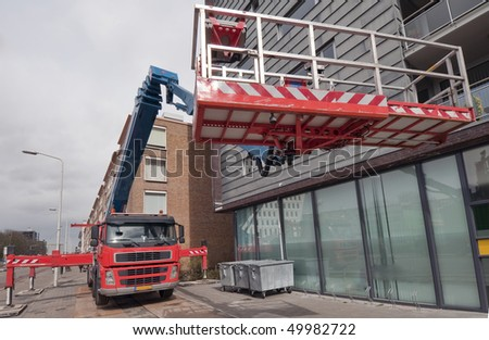 Truck with aerial access platform - stock photo