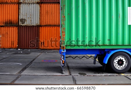 Truck with container in a terminal - stock photo