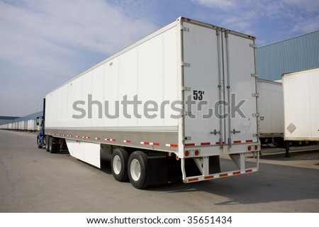 Truck with environmental flap in yard from behind - stock photo