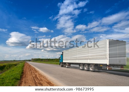 truck with freight on the highway - stock photo