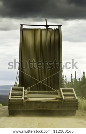 Truck with oversize load on the gravel road of Alaska - stock photo