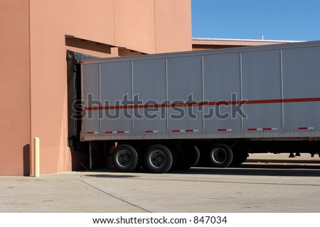 Trucks at loading dock - stock photo