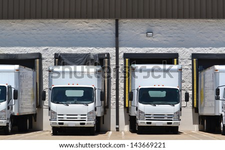 trucks at loading dock shipping industry - stock photo