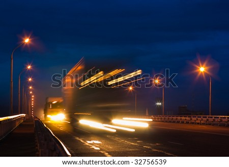 Trucks on night road