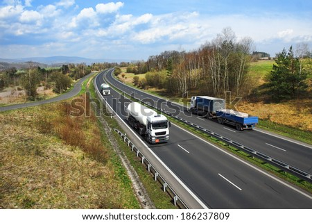 Trucks on the highway. - stock photo